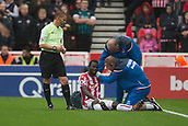 30th September, bet365 Stadium, Stoke-on-Trent, England; EPL Premier League football, Stoke City versus Southampton; Stoke City's Mame Biram Diouf receives medical treatement