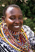 Lolgorian, Kenya. Siria Maasai Manyatta; Eunice, woman, traditional beadwork earrings, decorations, extended ear piercing.
