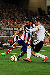 Atletico de Madrid´s Arda Turan and Valencia CF´s Jose Gaya during 2014-15 La Liga match between Atletico de Madrid and Valencia CF at Vicente Calderon stadium in Madrid, Spain. March 08, 2015. (ALTERPHOTOS/Luis Fernandez)