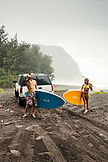 USA, Hawaii, The Big Island, a couple unloads their truck and prepares to paddle board in Waipio Valley