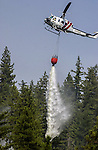 August 22, 2001 Coulterville, California  -- Creek Fire – CDF helicopter drops water on Cuneo Road hot spot.  The Creek Fire burned 11,500 acres between Highway 49 and Priest-Coulterville Road a few miles north of Coulterville, California.