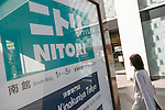 A woman walks past a Nitori signboard on display near to the new Nitori department store in Shinjuku's Takashimaya Times Square on December 9, 2016, Tokyo, Japan. Nitori Holdings opened the new furniture and home accessory store in the South Hall of Tokyo's Takashimaya Times Square commercial complex on December 1st. The company plans to increase the number of its stores to 2000 overseas and 1000 in Japan by 2032. (Photo by Rodrigo Reyes Marin/AFLO)