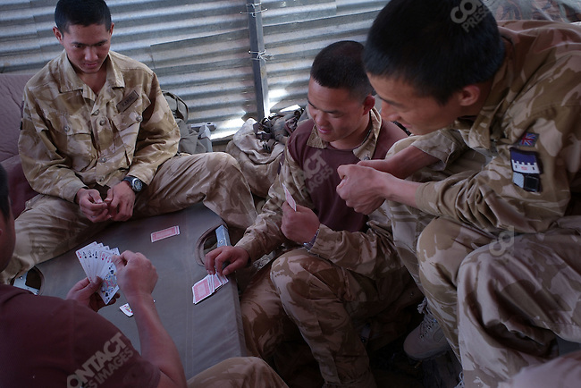B Co. Royal Gurkha Rifles (1RGR) playing cards on the frontline in Garmsir.Helmand, Afghanistan, November 2007.