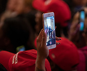 An attendee makes a video as he watches United States President Donald J. Trump address the 2018 Young Black Leadership Summit at The White House in Washington, DC on Friday, October 26, 2018. <br /> Credit: Chris Kleponis / Pool via CNP