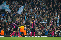 Lionel Messi of Barcelona & teammates ate left in disappointment during the UEFA Champions League match between Manchester City and Barcelona at the Etihad Stadium, Manchester, England on 1 November 2016. Photo by Andy Rowland / PRiME Media Images.