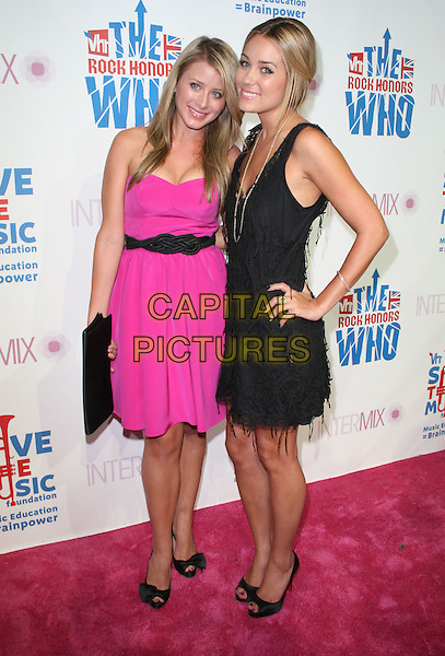 LO BOSWORTH & LAUREN CONRAD .Intermix's 3rd Annual VH1 Rock Honors VIP Party held at Intermix Boutique, Los Angeles, California, USA..July 11th, 2008.full length pink black dress hand on hip belt clutch bag .CAP/ADM/FS.©Faye Sadou/AdMedia/Capital Pictures.