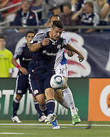 New England Revolution forward Milton Caraglio (9) passes the ball. In a Major League Soccer (MLS) match, the San Jose Earthquakes defeated the New England Revolution, 2-1, at Gillette Stadium on October 8, 2011.