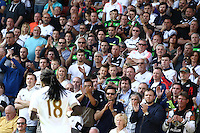 Swansea fans  applaud Bafetimbi Gomis of Swansea  during the Barclays Premier League match Watford and Swansea   played at Vicarage Road Stadium , Watford