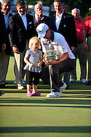 Bethesda, MD - June 29, 2014: Justin Rose shows of the Quicken Loans National trophy to his daughter Charlotte  after winning the Quicken Loan National at Congressional Country Club in Bethesda MD. The win gives Rose a total of six PGA Tour titles. (Photo by Phillip Peters/Media Images International)