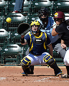 Michigan Wolverines Softball catcher Caitlin Blanchard (44) and umpire Rick Tumblestone during a game against the Bethune-Cookman on February 9, 2014 at the USF Softball Stadium in Tampa, Florida.  Michigan defeated Bethune-Cookman 12-1.  (Copyright Mike Janes Photography)
