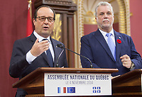 French President Francois Hollande speaks as Quebec Premier Philippe Couillard looks on at the National Assembly in Quebec city, Tuesday November 4, 2014.<br /> <br /> PHOTO :  Francis Vachon - Agence Quebec Presse