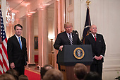 United States President Donald J. Trump, center, makes remarks as he hosts a ceremonial swearing-in ceremony for Associate Justice of the US Supreme Court Brett Kavanaugh, left, in the East Room of the White House in Washington, DC on Monday, October 8, 2018.  Kavanaugh formally took the oath on Saturday, hours after he was confirmed by the US Senate.  At right is former Associate Justice of the Supreme Court Anthony M. Kennedy.<br /> Credit: Ron Sachs / CNP<br /> (RESTRICTION: NO New York or New Jersey Newspapers or newspapers within a 75 mile radius of New York City)