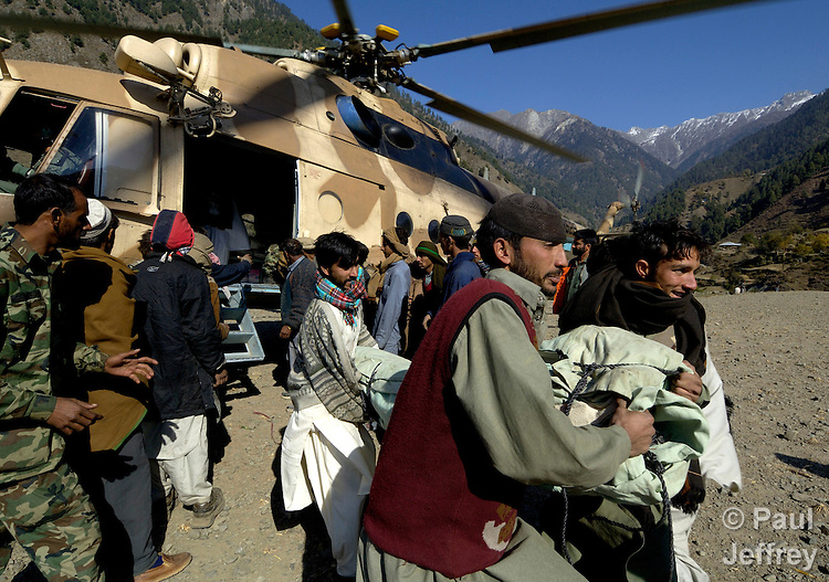 Following an October 8, 2005, earthquake in Pakistan, international aid organizations responded quickly to the needs of thousands of affected families. Here a Pakistan Army helicopter is used to ferry relief supplies provided by Church World Service/Action by Churches Together to the remote village of Gantar. The quake measured 7.6 on the Richter scale and killed more than 74,000 people in northern Pakistan.