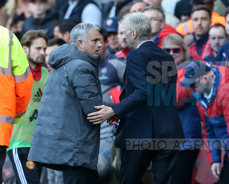 Arsenal's Arsene Wenger shakes hands with Manchester United's Jose Mourinho at the final whistle during the Premier League match at the Emirates Stadium, London. Picture date: May 7th, 2017. Pic credit should read: David Klein/Sportimage