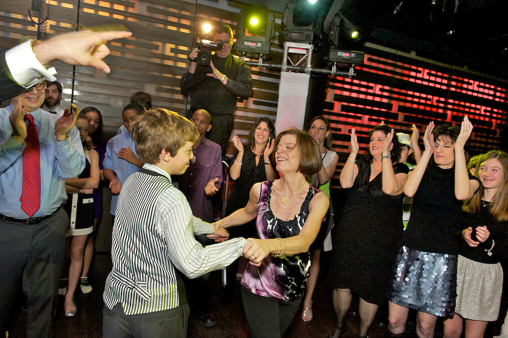 The Bar Mitzvah boy dancing with his mother
