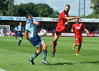 Joe McNerney of Crawley Town and Luke O'Niel of Wycombe Wanderers during the Sky Bet League 2 match between Crawley Town and Wycombe Wanderers at Broadfield Stadium, Crawley, England on 6 August 2016. Photo by Alan  Stanford / PRiME Media Images.