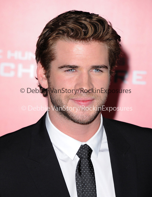 LOS ANGELES, CA - NOVEMBER 18: Liam Hemsworth arrives at   THE HUNGER GAMES: CATCHING FIRE L.A. Premiere held at Nokia Live  in Los Angeles, California on November 18,2012                                                                               © 2013  Hollywood Press Agency