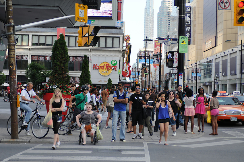 Diversity in full glory, on the move on a sunny day at Yonge Dundas Square, Toronto, Canada