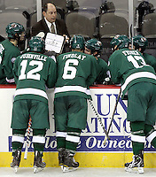 Bemidji State Head Coach Tom Serratore goes over a play with his team during the second period. Bemidji State beat UNO 4-2 Friday night during the first round of the WCHA playoffs at Qwest Center Omaha. (Photo by Michelle Bishop)