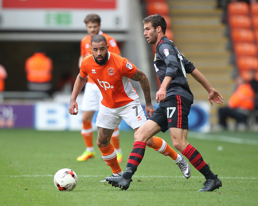 Blackpool's Kyle Vassell closes down Doncaster Rovers' Matty Blair<br /> <br /> Photographer Mick Walker/CameraSport<br /> <br /> The EFL Sky Bet League Two - Blackpool v Doncaster Rovers - Saturday 22nd October 2016 - Bloomfield Road - Blackpool<br /> <br /> World Copyright &copy; 2016 CameraSport. All rights reserved. 43 Linden Ave. Countesthorpe. Leicester. England. LE8 5PG - Tel: +44 (0) 116 277 4147 - admin@camerasport.com - www.camerasport.com