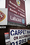 Advertising signs outside the stadium before Burnley hosted Everton in an English Premier League fixture at Turf Moor. Founded in 1882, Burnley played their first match at the ground on 17 February 1883 and it has been their home ever since. The visitors won the match 5-1, watched by a crowd of 21,484.