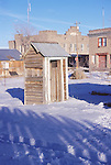 Wooden outhouse in the snow, Goldfield, Nev.