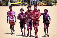 Indian boys celebrating annual Hindu Holi festival of colours smeared with powder paints in Mumbai, formerly Bombay, Maharashtra, India