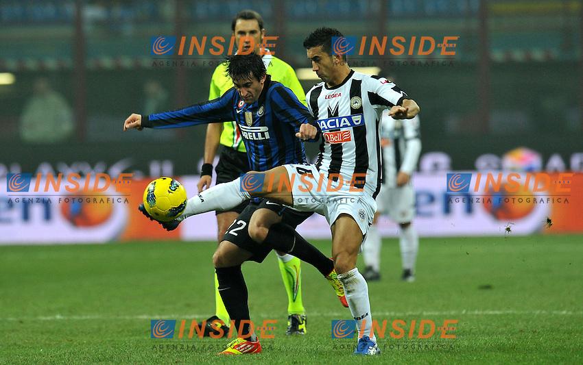 "Diego MILITO (Inter), Giampiero PINZI (Udinese).Milano 3/12/2011 Stadio ""Giuseppe Meazza"".Serie A 2011/2012.Football Calcio Inter Vs Udinese.Foto Insidefoto Alessandro Sabattini."