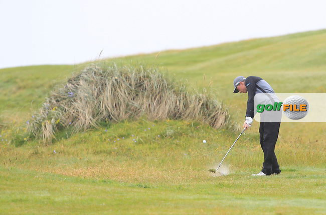 Stuart Grehan (Tullamore) on the 4th fairway during Matchplay Semi Final of the South of Ireland Amateur Open Championship at LaHinch Golf Club on Sunday 26th July 2015.<br /> Picture:  Golffile | TJ Caffrey