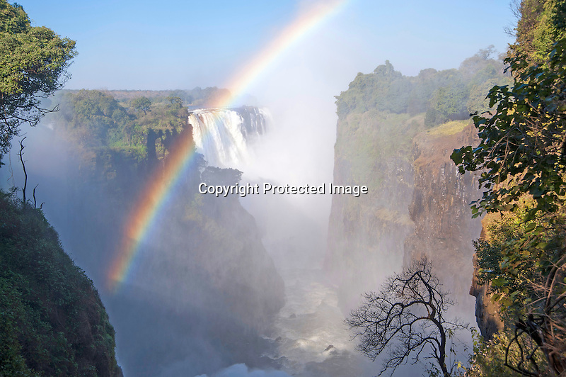Rainbow over Majestic Victoria Falls in Zimbabwe