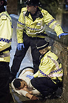 © Joel Goodman - 07973 332324 . FILE PICTURE DATED 05/05/2013 of police tending to a man lying on the ground in Central Manchester overnight , as the British Home Secretary , Theresa May , takes questions at the annual Police Federation conference on licensing and policing the night time economy , today (Wednesday 15th May 2013) . Photo credit : Joel Goodman