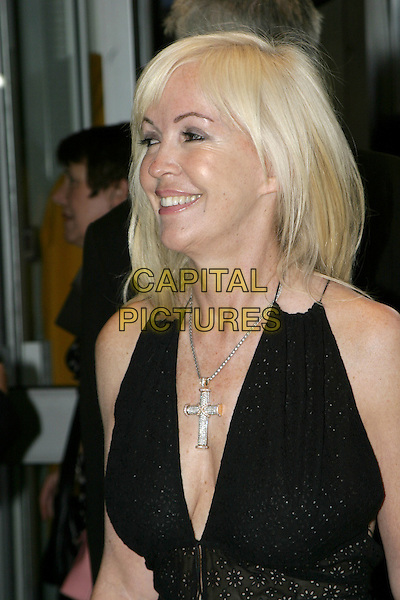 SALLY GREEN.UK Premiere of M. Night Shyamalan's The Village at Odeon West End Leicester Square, London W1.August 10th, 2004.headshot, portrait, plunging neckline, cleavage, cross, crucifix, jewellery.www.capitalpictures.com.sales@capitalpictures.com.© Capital Pictures.