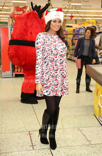 Jessica Wright. Celebrities surprise Morrisons shoppers by packing their bags  to raise money for ITV&rsquo;s charity appeal, Text Santa<br /> London. 12/12/2013 Picture by: Henry Harris / Featureflash