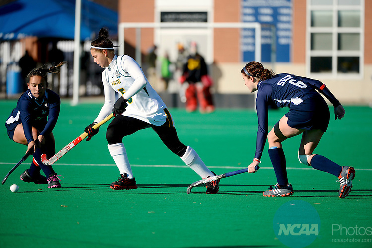 24 NOV 2013: Ari Saytar (19) and Lauren Taylor (6) of Shippensburg University try to contain Dani Crouse (5) of Long Island University Post during the 2013 NCAA Women's Division II Field Hockey Championship held at Powhatan Field at L.R. Hill Sports Complex on the campus of Old Dominion University in Norfolk, VA. Shippensburg defeated LIU Post 2-1 in overtime to win the national title. Brett Wilhelm/NCAA Photos