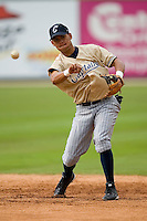 Jansy Infante (22) makes a throw to first base during fielding practice at Fieldcrest Cannon Stadium in Kannapolis, NC, Saturday, April 26, 2008.
