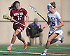 Madeline Podaras #11 of North Shore, left, gets pressured by Siobhan Rafferty #16 of Long Beach during the Nassau County varsity girls lacrosse Class B quarterfinals at Long Beach High School on Thursday, May 19, 2016. Long Beach won 9-8 in overtime.