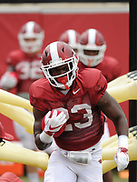 NWA Democrat-Gazette/ANDY SHUPE<br /> Arkansas running back Maleek Williams carries the ball through a practice device Tuesday, Aug. 1, 2017, during practice at the university's practice field in Fayetteville. Visit nwadg.com/photos to see more photographs from the day's practice.