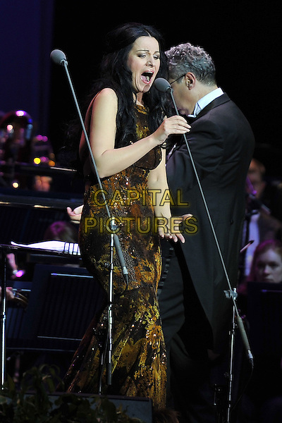 Angela Gheorghiu .performing on stage at the O2 Arena, London, UK, July 29th, 2011..music opera singer concert live half length gold dress  black hand 3/4  microphone singing.CAP/MAR.© Martin Harris/Capital Pictures.