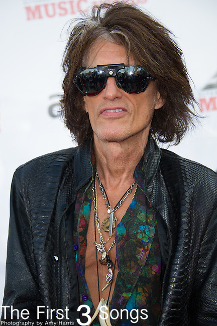 Joe Perry of Aerosmith attends the 2014 AP Music Awards at the Rock And Roll Hall Of Fame and Museum at North Coast Harbor in Cleveland, Ohio.