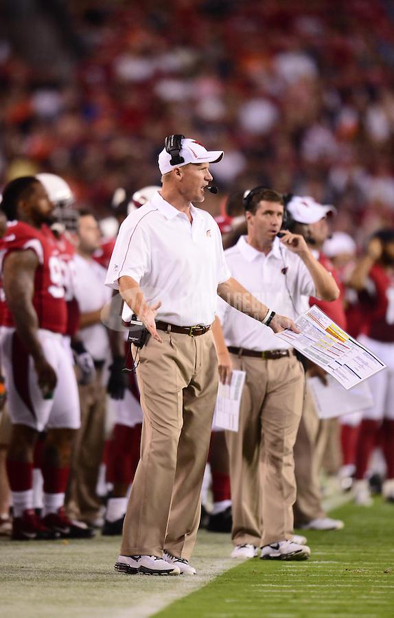 Aug. 30, 2012; Glendale, AZ, USA; Arizona Cardinals head coach Ken Whisenhunt reacts against the Denver Broncos during a preseason game at University of Phoenix Stadium. Mandatory Credit: Mark J. Rebilas-