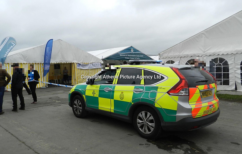 COPY BY TOM BEDFORD<br />Pictured: An ambulance at the scene. Wednesday 15 August 2018<br />Re: Six people have been injured when a horse bolted during the Pembrokeshire County Show in west Wales, UK.<br />The horse broke loose from a show ring onto the main thoroughfare during the show in Withybush, near Haverfordwest and knocked several people over.<br />The Air Ambulance attended the scene along with police and ambulances.<br />Parts of the showground were closed off as a result of the incidentand the horse has since been captured.