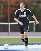 Ward Melville No. 11 Kyle Honor moves the ball downfield during the first half of a Suffolk County varsity boys' soccer Class AA first round playoff game against host North Babylon High School on Tuesday, October 27, 2015. Ward Melville won by a score of 1-0.<br /> <br /> James Escher
