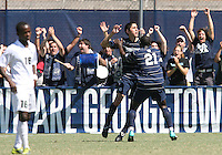Andy Riemer #20 of Georgetown University celebrates his goal with Henry Tembon #21 while Cyrus Saydee #16 of Michigan State looks dejected during an NCAA match at North Kehoe Field, Georgetown University on September 5 2010 in Washington D.C. Georgetown won 4-0.
