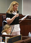 Nevada Sen. Patricia Farley, R-Las Vegas, works on the Senate floor with her daughter Brooke at the Legislative Building in Carson City, Nev., on Friday, April 3, 2015. <br /> Photo by Cathleen Allison