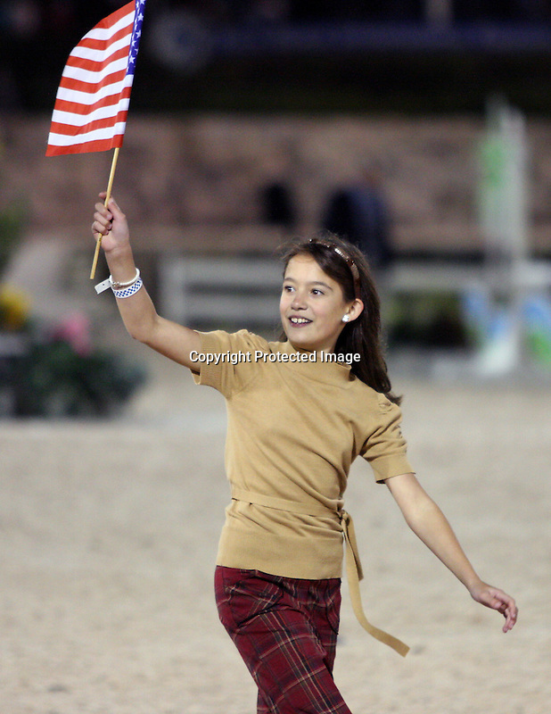 A young American shows her support for the U.S. showjumping team during an intermission of the $75,000 FEI Nations Cup, an Olympics-style show jumping event, on Friday night, Feb. 28, 2009, during the Winter Equestrian festival in Wellington, Fla. Photo by Bob Markey II