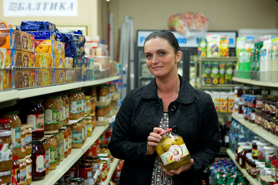 Galina Burley, holds a jar of pickled apples as she talks about Russian party food at Anoush Deli in Vancouver, Monday January 28, 2014. Burley, who's a local leader of the Russian speaking community, grew up in Sochi.(Natalie Behring/for the Columbian)
