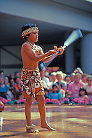 EDITORIAL ONLY. Young boy performing dance with long knife at Ala Moana Center