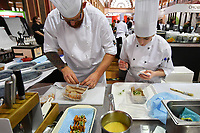Melbourne, 30 May 2017 - Andrew Ballard and Brooke Noble commis chef from the Simmer Culinary in Mornington work on garnishes at the Australian selection trials of the Bocuse d'Or culinary competition held during the Food Service Australia show at the Royal Exhibition Building in Melbourne, Australia. Photo Sydney Low