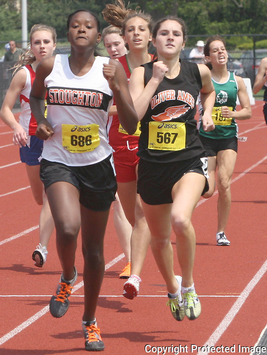 Stoughton's Jade Paul and Oliver Ames' Emily Grotz compete in the 800 meters during the state Division 2 Track & Field Championships on Saturday at Bridgewater State University.