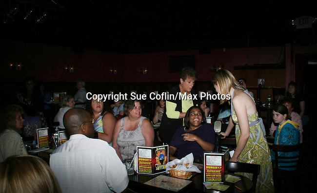 Fans pose with General Hospital's Natalia Livingston as she appears at the Brokerage Comedy Club on August 8, 2009 in Bellmore, New York. Autographs, photos and Q & A at the VIP Reception. (Photo by Sue Coflin/Max Photos)